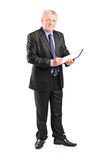 Mature businessman taking notes on piece of paper Stock Photo