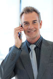 Mature businessman talking on phone Royalty Free Stock Image