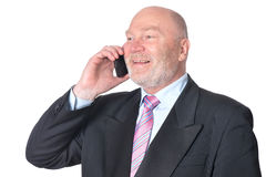 Mature businessman talking on the phone Royalty Free Stock Images