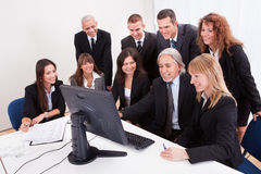 Mature Businessman With Team Discussing Stock Photo