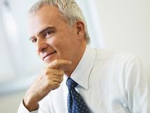 Mature businessman thinking Royalty Free Stock Photo