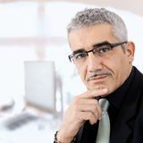 Mature businessman thinking Royalty Free Stock Image