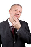 Mature businessman scratching his chin Stock Image