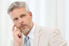 Mature Businessman Thinking Stock Photo