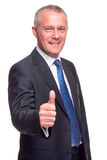 Mature businessman thumbs up. Royalty Free Stock Image