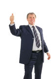 Mature businessman with thumbs up Royalty Free Stock Photo