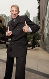 Mature businessman with thumbs up Royalty Free Stock Photos