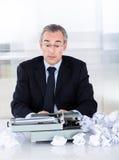 Mature businessman typing on typewriter Royalty Free Stock Photos