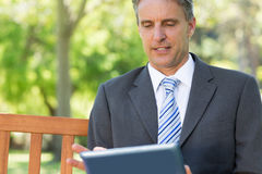 Mature businessman using digital tablet Royalty Free Stock Photos