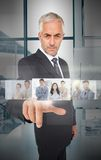 Mature businessman using futuristic interface Stock Photo