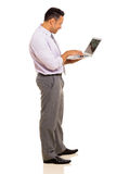 Mature businessman using laptop Stock Image
