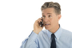 Mature Businessman Using Smart Phone. Isolated over white background Stock Photography