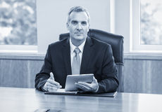Mature Businessman using tablet computer Royalty Free Stock Photos