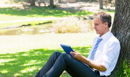 Mature businessman using tablet computer Stock Photography