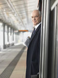 Mature Businessman Waiting At Empty Train Station Stock Image