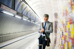 Mature businessman waiting on a metro station. Stock Photo