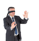 Mature businessman walking with blindfold Royalty Free Stock Photography