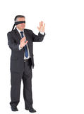 Mature businessman walking with blindfold Royalty Free Stock Photo