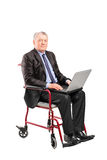 Mature businessman in a wheelchair Stock Photo