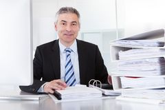 Mature businessman at work Royalty Free Stock Images