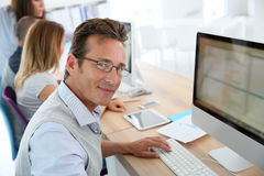 Mature businessman working on computer Stock Photo