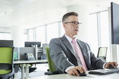 Mature businessman working on computer in office Royalty Free Stock Photo