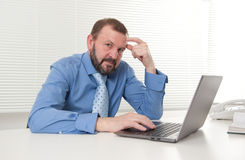 Mature businessman working on his laptop Stock Photography