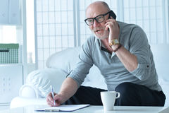 Mature businessman working at home. Working as freelancer Royalty Free Stock Photo