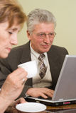 Mature businessman working with laptop Stock Image