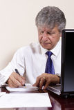 Mature businessman working with laptop in his office Stock Photo
