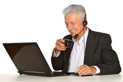 Mature businessman working with laptop Royalty Free Stock Photos