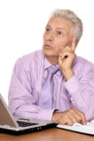 Mature businessman working with laptop Stock Photos