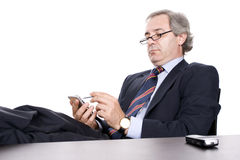 Mature Businessman working with PDA Royalty Free Stock Photos