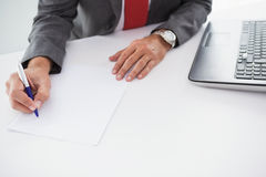Mature businessman writing on document Royalty Free Stock Images