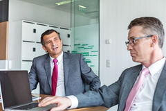 Mature businessmen discussing in office Royalty Free Stock Photos