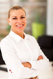 Mature businesswoman. Happy mature businesswoman in office Stock Images