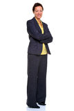 Mature businesswoman arms folded  on white Royalty Free Stock Photography