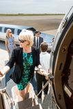Mature Businesswoman Boarding Private Jet Stock Photos