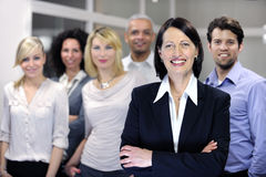 Mature businesswoman and business team Royalty Free Stock Photos