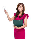 Mature businesswoman with clipboard pen up Stock Photography