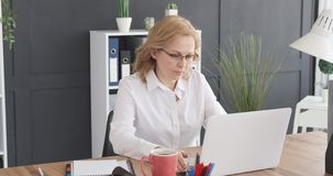 Businesswoman working on laptop at office stock footage