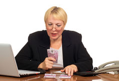 Mature businesswoman counting the money. Royalty Free Stock Photos