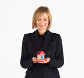 Mature businesswoman dreaming about a house Stock Photos