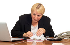 Mature businesswoman hiding the money Stock Photo