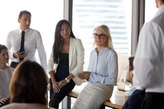 Mature businesswoman hold team meeting in conference room royalty free stock image