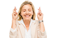 Mature businesswoman holding fingers crossed isolated on white b Stock Image
