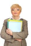 Mature businesswoman holding folders Royalty Free Stock Photos