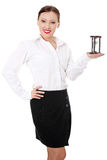 Mature businesswoman with hourglass Stock Images