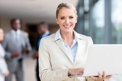 Mature businesswoman laptop computer Stock Images