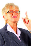 Mature Businesswoman Pointing Up Stock Photography